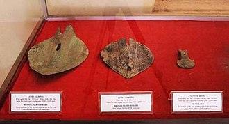 Cổ Loa Citadel - Image: Bronze ploughshares and axe heads Cổ Loa Citadel