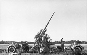 8.8 cm Flak 18/36/37/41 - 88 being emplaced, with both bogies already detached