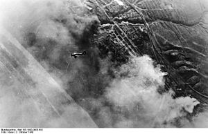 Bombing of Stalingrad - Smoke rises from the ruins of Stalingrad after German bombing of the city on 2 October 1942