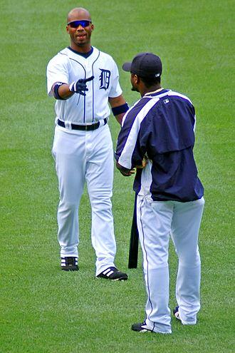 Craig Monroe - Monroe (left) talks to teammate Fernando Rodney in 2006.