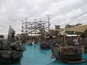 Castaway Bay (Sea World) - Battle Boats in the foreground with Sky Climb in the background.