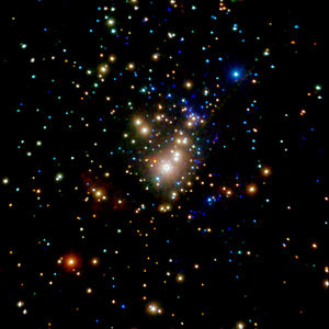 Star cluster - The embedded Trapezium cluster can be seen in X-ray light which penetrates the cloud.