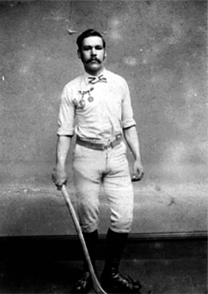 Bluntisham - Charles Goodman Tebbutt with a bandy stick