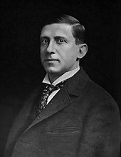 Formal half-length portrait of a man of about 40. He is wearing a dark jacket, white shirt, and tie.