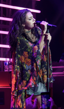 Charli XCX performing at the 'Artist to Watch' Concert.png