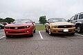 Chevrolet Camaro 2010 RS Ford Mustang 2010 Fronts NMUSAF 26Sep09 (14596951311).jpg