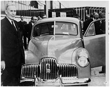 Then-Prime Minister of Australia Ben Chifley at the launching of the first mass-produced Australian car at the General Motors-Holden factory, Fisherman's Bend.