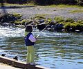 Child fishes in stream.jpg