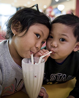 Children sharing a milkshake