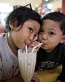 Children sharing a milkshake.jpg
