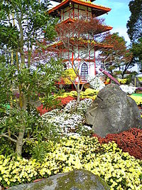 A pagoda covered in chrysanthemums