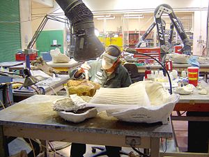 Royal Tyrrell Museum of Palaeontology - Image: Cleaning fossil