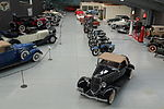 Collection of vintage cars and motorcycles in Warbirds & Wheels museum.jpg