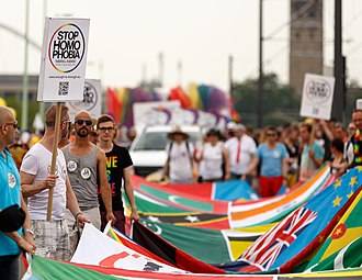 LGBT activists at Cologne Pride carrying a banner with the flags of over 70 countries where homosexuality is illegal. Cologne Germany Cologne-Gay-Pride-2015 Parade-17b.jpg