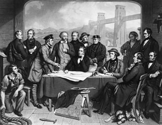 Britannia Bridge - An 1868 engraving showing Robert Stephenson (seated centre) with the engineers who designed and built the Britannia Bridge.