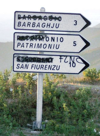 National Liberation Front of Corsica - A road sign near Bastia with the non-Corsican place names defaced.