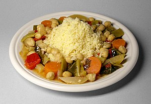 Culture of Algeria - Couscous (Arabic: كسكس) with vegetables and chickpeas, the national dish of Algeria.