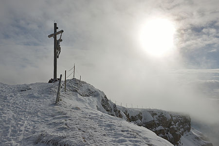 Woodcarved summit cross on the mount Seceda 2519 m. in Gröden