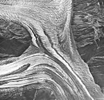 Crillon Glacier, divide of north and south Crillon Glacier with large medial and lateral moraines, September 16, 1966 (GLACIERS 5332).jpg