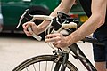 Cycling pressing brakes on bicycle.jpg