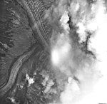 Dawes Glacier, tidewater glacier partially obscured by clouds, August 20, 1968 (GLACIERS 5385).jpg