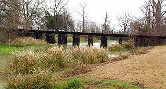 Deer Creek (Mississippi) - Bridge  of abandoned Illinois Central Railroad line across Deer Creek in Scott