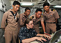 Defense.gov News Photo 100514-N-7643B-004 - U.S. Navy Seaman Katelynn L. Ehrs discusses network and communication training with Royal Thai Navy sailors aboard the amphibious dock landing ship.jpg