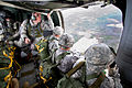 Defense.gov News Photo 101129-A-3108M-006 - U.S. Army Staff Sgt. David Harp prepares paratroopers with 1st Brigade Combat Team to jump from a UH-60M Black Hawk helicopter at Fort Bragg N.C..jpg