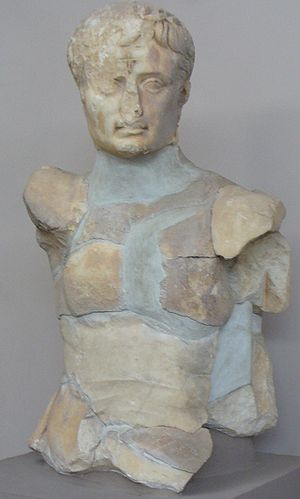 Persecution of pagans in the late Roman Empire - A cult statue of the deified Augustus, disfigured by a Christian cross carved into the emperor's forehead.