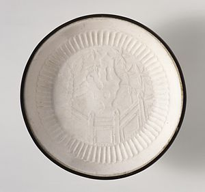 "Ding ware - Dish (Pan) with Garden Landscape, described by LACMA as ""molded stoneware with impressed decoration, transparent glaze, and banded metal rim"", 13th century, diameter 5.5 in. (14 cm)"