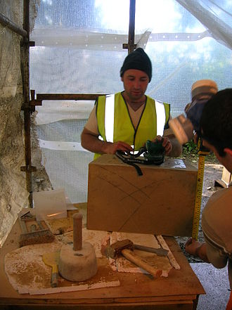 Stonemasonry - A stonemason at Eglinton Tournament bridge with a selection of tools of the trade