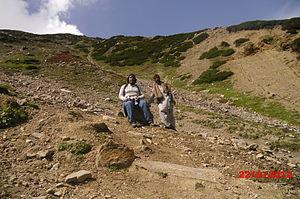 Ansoo Lake - Image: Engr. Talha Masood Khan resting at 3 hours into the trek. Guide Malik is standing adjacent