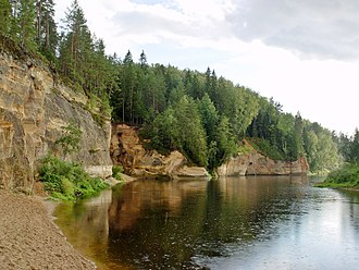 Gauja - Devonian sandstone cliffs: the Ērgļu cliffs along the Gauja river