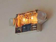 Light Bulbs For Exit Signs: Inside of an emergency light/exit sign combination unit with light bulbs  and backup battery,Lighting