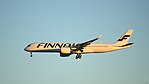 Finnair's first Airbus A350 (OH-LWA) on finals at Helsinki Airport.jpg
