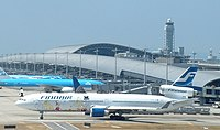 Finnair MD-11 (OH-LGF) taxiing at Kansai International Airport.jpg