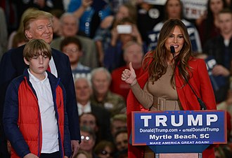 Melania Trump - Melania gives the thumbs up at a campaign event with her husband Donald and son Barron, November 2015