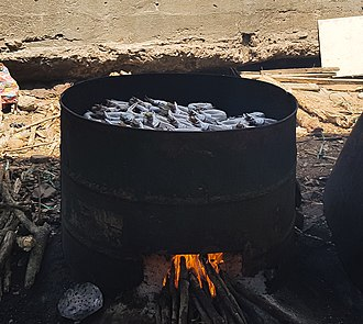 Smoking of fish over an open fire in Ghana, 2018 Fish smoking in Ghana.jpg