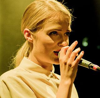 Florrie English pop singer-songwriter, drummer and model