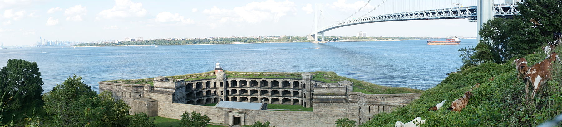 Panorama of the Upper New York Bay viewed from Staten Island. The Verrazano-Narrows Bridge is visible in the center of the image and Fort Wadsworth is visible in the foreground.