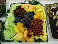 Fruit tray including pineapple honeydew melon oranges grapes.JPG
