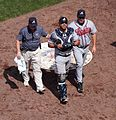 Gerald Laird being escorted off the field by manager Fredi Gonzalez and trainer Jeff Porter.JPG