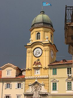 The Baroque city clock tower above the arched gateway linking the Korzo to the inner city, designed by Filbert Bazarig in 1876