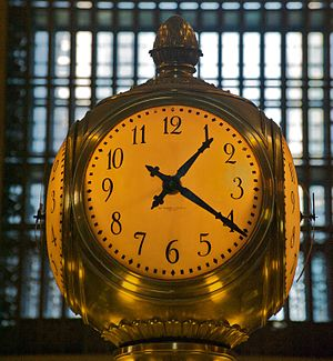 Chester H. Pond - Clock in Grand Central Terminal on the information kiosk. The clock has 4, 24 inch dials and was made by the Self Winding Clock Company. It was installed in 1913.