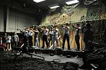 Gunsan City Police Department officers take aim with M9 handgun simulator weapons.JPG