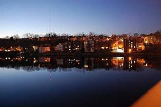 Haverhill, Massachusetts - Haverhill, Massachusetts downtown (River Street) pictured at dusk from the Comeau Bridge over the Merrimack River