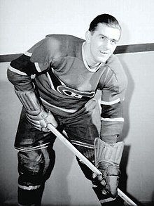 Richard poses for a photographer while wearing his full Canadiens uniform