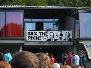 "Progressive tax - ""Tax The Rich"" banner at an International Union of Socialist Youth campaign for a financial transaction tax."