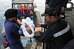 Indian Navy officers transfer a kid from boat (01).JPG