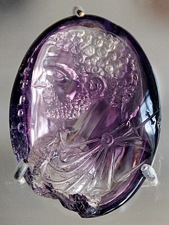 Engraved gem - Roman intaglio portrait of Caracalla in amethyst, once in the Treasury of Sainte-Chapelle, when it was adapted by adding an inscription and cross to represent Saint Peter.